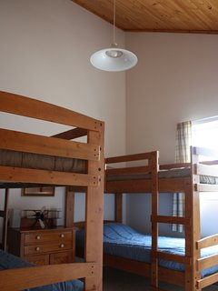 Bunk bedroom with tall cathedral ceilings