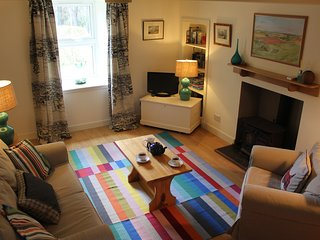 Bright comfortable sitting room with wood burner for those cosy nights in.
