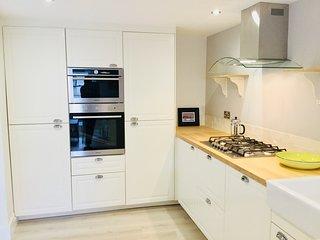 Modern kitchen with family sized fridge/freezer and integrated dishwasher
