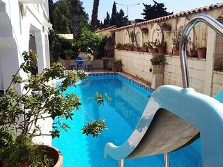 Villa , 7 bedroom , sleeps 17 people , has a pool . Brilliant Location. Perfect