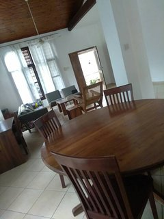 Livingroom with diningroom and open kitchen. Kitchen : Gas cooker, fridge, microwave and crockery