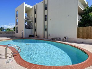 NEW LISTING! Modern condo with shared pool only moments away from the beach