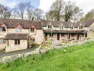 THE BARN, terraced barn conversion, on working farm, parking, in Llangollen, Ref