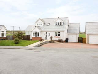 14 CAE DERWYDD, conservatory, balcony, countryside and sea views, near Cemaes Ba
