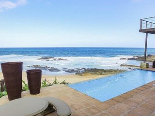 BEACH HOUSE,BALLITO. RIGHT ON TINLEY MANOR BEACH OPPOSITE THE TIDAL POOL.