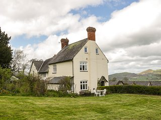 BROUGHTON COTTAGE, pet-friendly, open fire, farm setting, country views, close