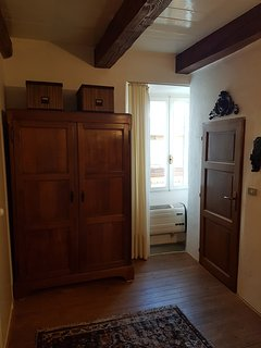 Wardrobe of mezzanino bedroom and window overlooking the vicolo.