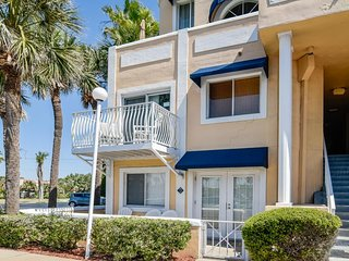 Bright corner condo features a shared pool and beach access!