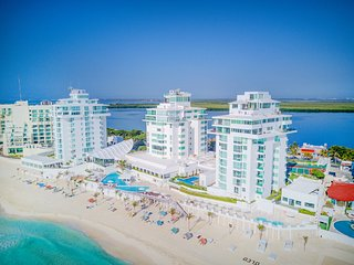 We are located right on the beach, Oleo Cancun Playa is the name. Closest tower, rooftop is #3000.