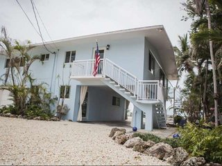 Seaside Retreat with Direct Ocean Views, Private, Sandy Beach, Pool & Boat Basin