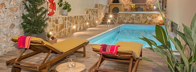 The swimming pool is constructed in a very beautiful landscaped and private space