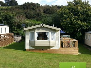 Beautiful caravan on family friendly site with pool. 0.6 miles to beach