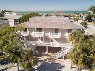 Immaculately Furnished 2BD/2BA, Steps from the Gulf w/ Heated Pool and Laundry