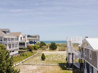 Catch some rays at this oceanside duplex on a north end private drive
