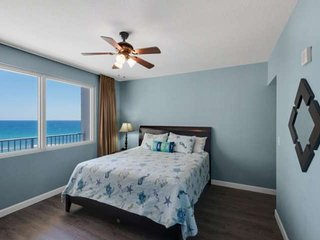 King Sized bed with a picture window.  Views of the Gulf of Mexico. Private bathroom
