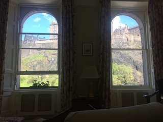 View of Edinburgh Castle and hill as seen from inside the apartment, through sitting room windows.