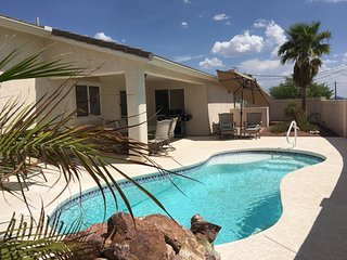 Relaxing, clean home w/ boat deep garage, pool & entertainment amentities.