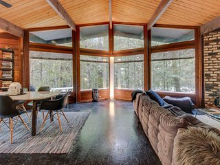 Unique and stylish home w/ hot tub, deck, shared pool, firepit & forest views!