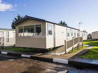 8 berth caravan with D/G & C/H at the Seawick Holiday Park. REF 27041