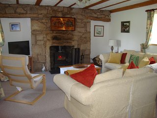 Lounge with wood burning fire.  Lovely views to front and back of countryside.