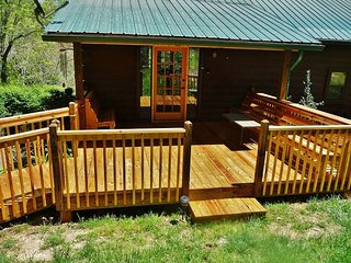 Front deck and benches invite you to relax, or enjoy the other two decks on the back of the house!