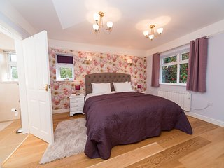 Spacious bedroom with super kingsize bed and ensuite shower room.