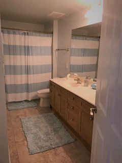 Large hallway bath with tub/shower combo and extra large double vanity