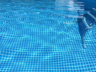 Pool size 10 m long x 5 m  wide x 1.30 m deep, blue, clear and inviting.