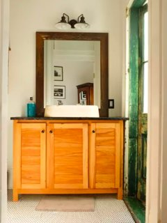 custom vanity with anqitue sink with original features with a rustic shabby chic vibe historic home