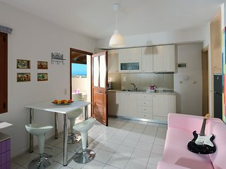 Charming retro studio with shared pool and view