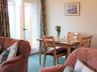 There is level access from the dining area of Mungo's Well cottage into the conservatory.