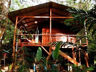 Tranquila Cabin surrounded by tropical gardens, fo