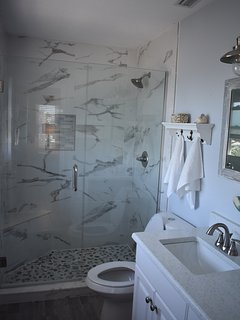 Brand new tile & fixtures in walk-in Shower in Master Bathroom.