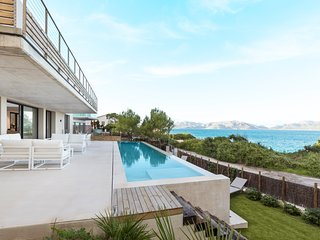 Can Torres - Waterfront Premium Design Villa with infinity pool