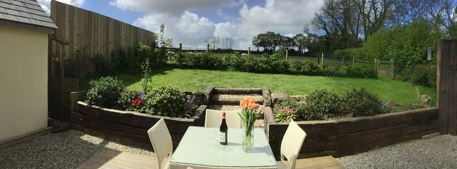 Panorama of the private, south west facing garden.
