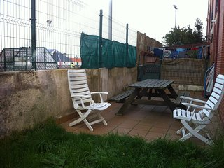 Terraza con jardín privada.