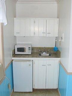 Mini kitchen. Microwave, fridge, hot plate, toaster, coffee marker, wine glasses, etc.