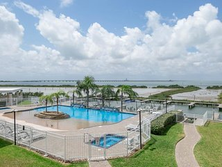 Oceanfront beauty with shared hot tub, community pool, boat slips, & views