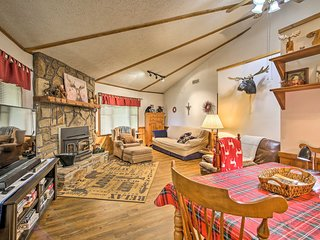 Inside, you'll find 4 bedrooms, 4 bathrooms, and tasteful rustic decor!