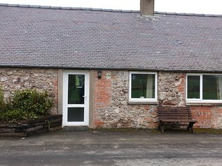 THE CROFTER'S COTTAGE, woodburner, exposed beams, traditional features, near Col