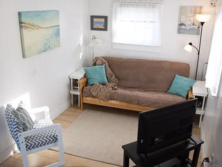 Pet friendly cottage near the beach and across from the pool!