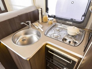 kitchen area includes sink, fridge/freezer, hob, oven. [note  this is a catalogue picture]