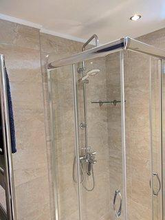 Luxury shower with heated towel radiator