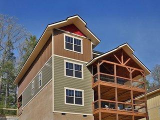 Dive Right In a 4 bedroom cabin with indoor pool in Laurel Estates.