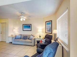 Comfortable resort-style condo with ocean views, shared pool, and hot tub!