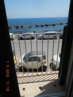 Uninterrupted view of the sea from the balcony with the external shutters outside.