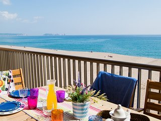 Seafront apartment , on the beach.