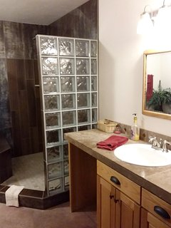 Queen 'Pond Suite' private bathroom has gorgeous oversized custom tile shower with bench.