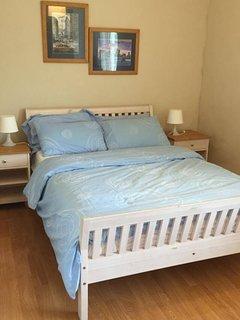 Double Bedroom with wardrobe, bedside lockers.