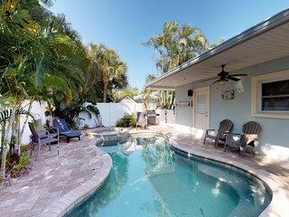 Bright and beachy house with a private pool - beach across the street!